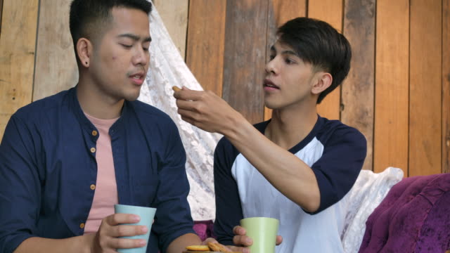 male homosexual sit and drink coffee and talk - coffee drink stock videos & royalty-free footage