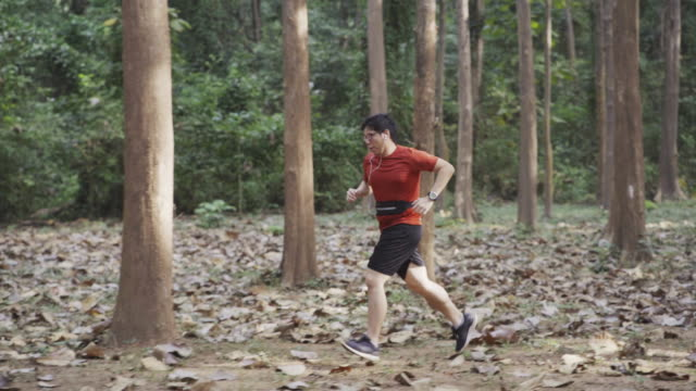 TS Male in Red Sport T-Shirt Running in Forest