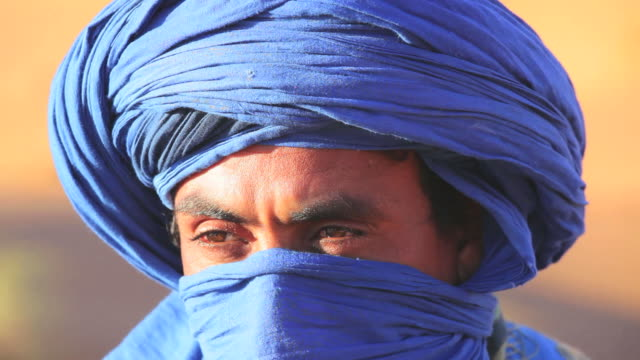 Male in traditional blue Touareg Headress, Sahara Morocco Africa