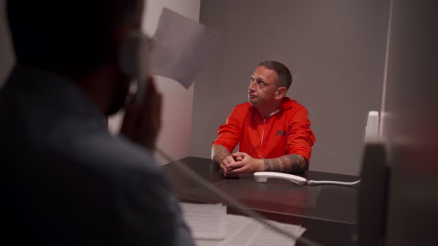 male inmate talking with his lawyer in prison visit room - prosecutor stock videos & royalty-free footage