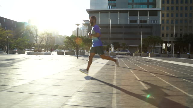 Male jogger running in a city