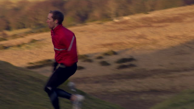 ms, ts, male jogger running up hill, wales, united kingdom - achievement stock videos & royalty-free footage