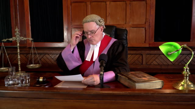 4K DOLLY: Male Judge in Court listening to case