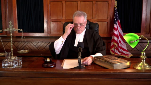 4K DOLLY: USA Male Judge in Court listening to case