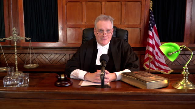 4K DOLLY: USA Male Judge in Courthouse listening to case