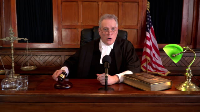 4K DOLLY: USA Male Judge in Courtroom using Gavel