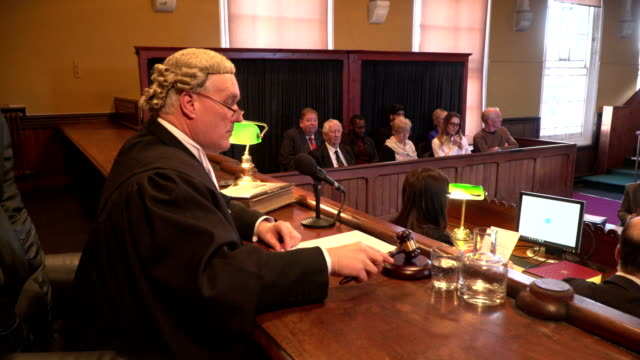 4k dolly: male judge in courtroom with jury - judges stock videos and b-roll footage