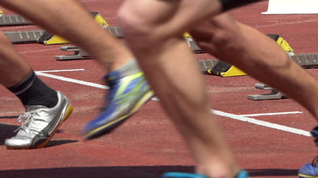 male junior sprinters starting from the starting block - human leg stock videos & royalty-free footage