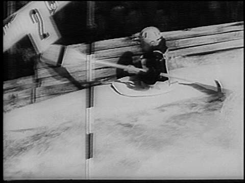 B/W 1966 male kayaker trying to steer from wall in slalom competition on rapids / Germany / newsreel