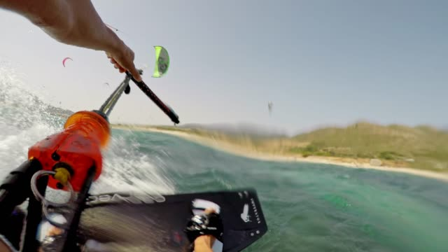 pov male kiteboarder riding in sunshine and jumping into the air - kiteboarding stock videos & royalty-free footage