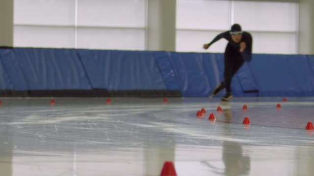 MS SLO MO Male long track speed skater racing on track in arena