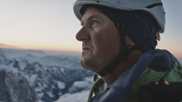 male looking at view from snowcapped mountain - headwear stock videos & royalty-free footage