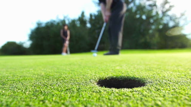male makes a putt - golf swing stock videos & royalty-free footage