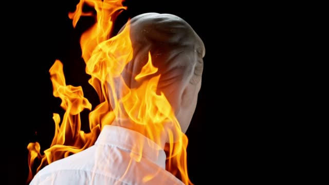 slo mo ld male mannequin in a white shirt catching fire - mannequin stock videos & royalty-free footage