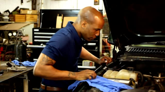 male mechanic working in auto repair shop. - personal land vehicle stock videos & royalty-free footage