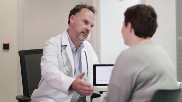 Male Medical Doctor explaining test results to patient