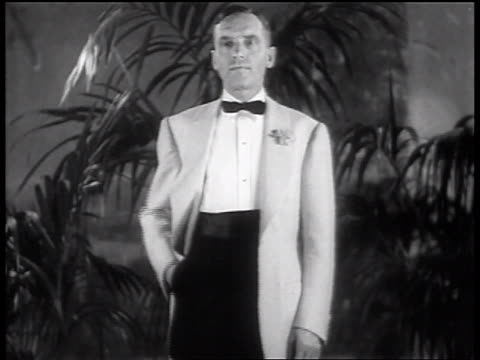 b/w 1937 male model buttoning light colored formalwear jacket - jacket stock videos and b-roll footage