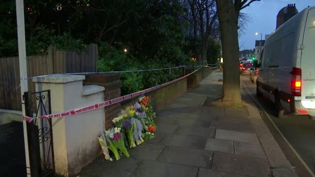Male model Harry Uzoka stabbed to death in Shepherd's Bush ENGLAND London Shepherd's Bush Police tape cordons along street and floral tributes on...