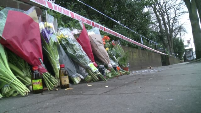 Male model Harry Uzoka stabbed to death in Shepherd's Bush EXT Roland Ferguson interview SOT Floral tribute on pavement Makeshift memorial by wall...