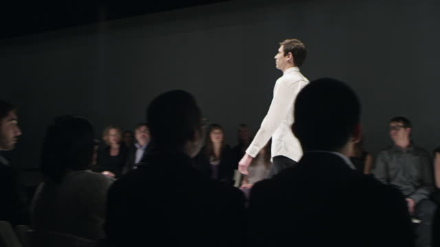 MS DS PAN Male model walking down catwalk during fashion show