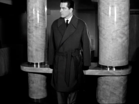 stockvideo's en b-roll-footage met male model wears a coat designed by hardy amies. 1961. - herenkleding