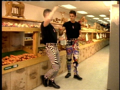 male models in colorful jeans eating pie - jeans stock videos & royalty-free footage