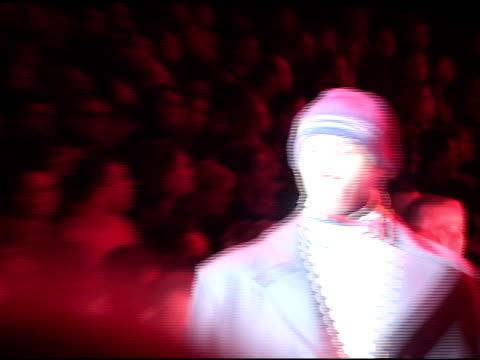 male models , one walking away, one toward, modeling fall, winter line, on catwalk, red light cast on runway. fashion week, designer clothes,... - デザイナー服点の映像素材/bロール