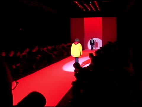 male models , one walking away, one walking toward, modeling fall, winter line on catwalk, runway w/ red light cast, back of press photographer's... - 2002 stock videos & royalty-free footage