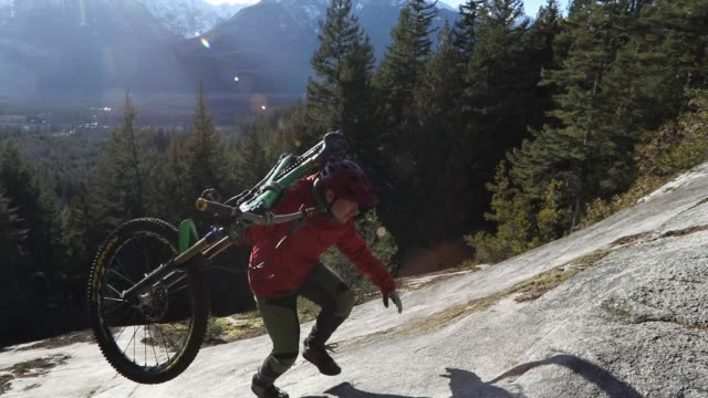 male mountain biker ascends rock slab at sunrise - carrying stock videos & royalty-free footage