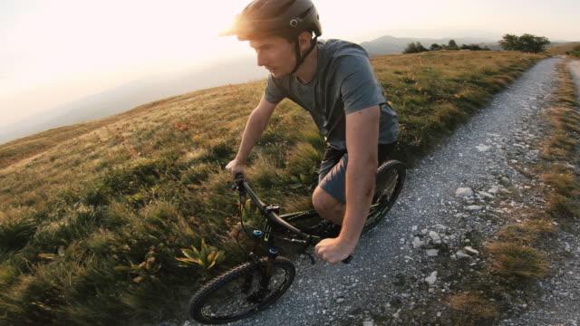 Male mountain biker cycling on mountain trail