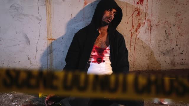 male murder victim in run-down urban location - murder victim stock videos & royalty-free footage
