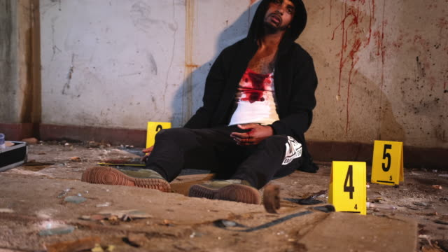 male murder victim in run-down urban location - run down stock videos & royalty-free footage