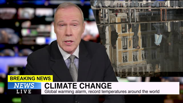male news presenter reading the evening news about climate change - news event stock videos & royalty-free footage