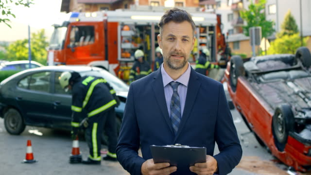 male news reporter at the scene of a car accident - road accident stock videos & royalty-free footage
