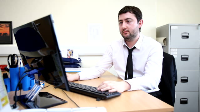 Male office worker at computer
