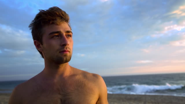 cu male on beach, turning to look at beach / venice, california, united states  - beautiful people stock videos & royalty-free footage