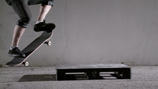 Male on skateboard performing grinding trick