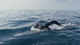 TS Male open water swimmer swimming front crawl in the sea