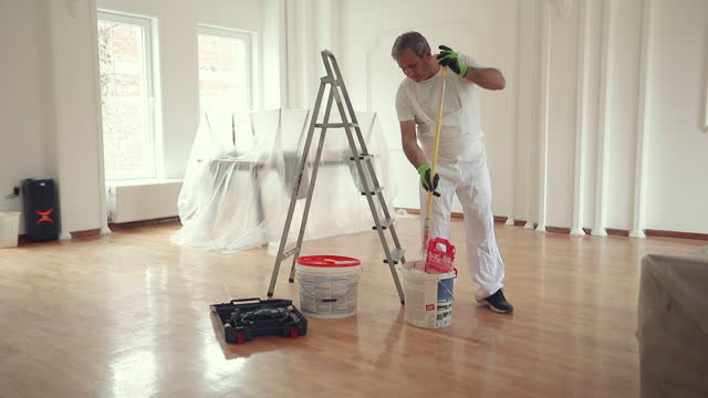 male painter painting a ceiling - mature men stock videos & royalty-free footage