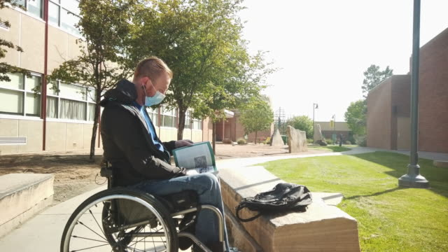 male paraplegic navigating in wheelchair outdoors on a sunny late summer day 4k video series - wheelchair stock videos & royalty-free footage