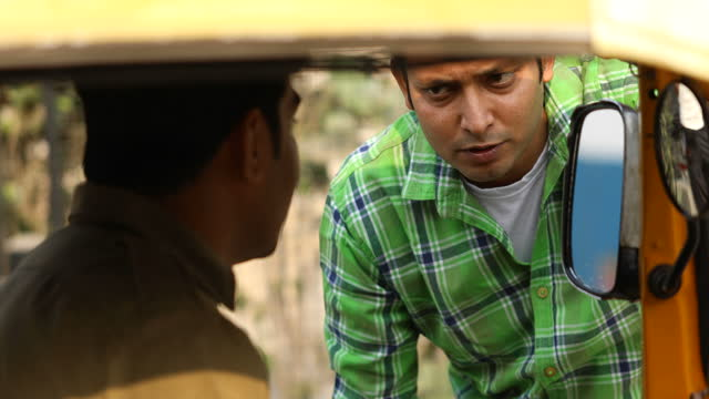 male passenger and rickshaw driver discussing about booking - banknote stock videos & royalty-free footage