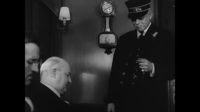 Male passenger talking to conductor about passing the Eastbound train VS Train passing window passing rare observation car INT MS Conductor talking...