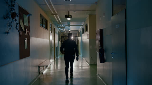 slo mo male patient walking down a clinic corridor - solitude stock videos & royalty-free footage