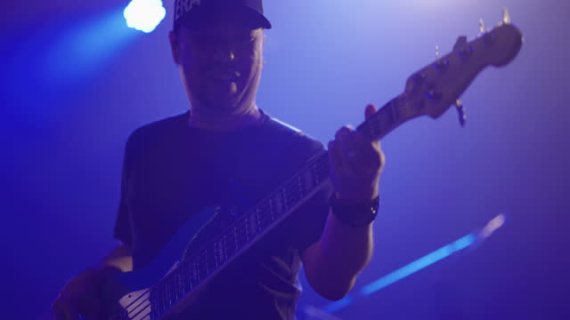 male performer bass on stage in concert - bass guitar stock videos & royalty-free footage