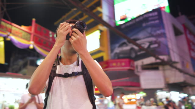 male photographer capturing photos at night market, yaowarat street food, bangkok, thailand - korean ethnicity stock videos & royalty-free footage