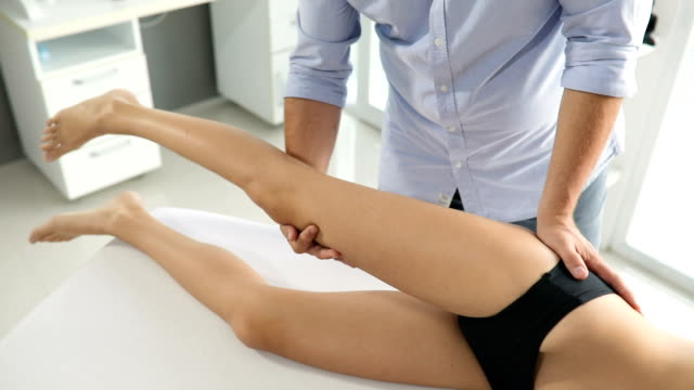 Male Physiotherapist Giving Leg Massage To Female Patient Stock Footage Video Getty Images