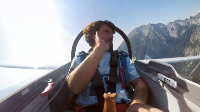 ld male pilot turning his glider upside down in the sunny sky - skill stock videos & royalty-free footage