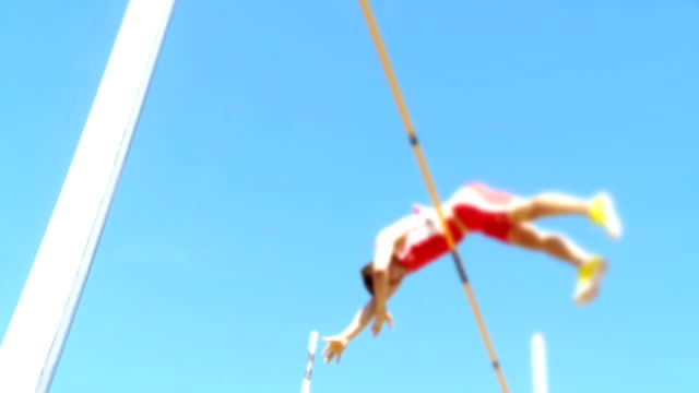 Male Pole Vaulter Clearing The Bar SLO MO