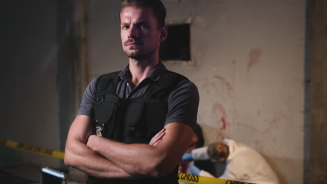 male police officer in bulletproof vest at crime scene - murder victim stock videos & royalty-free footage