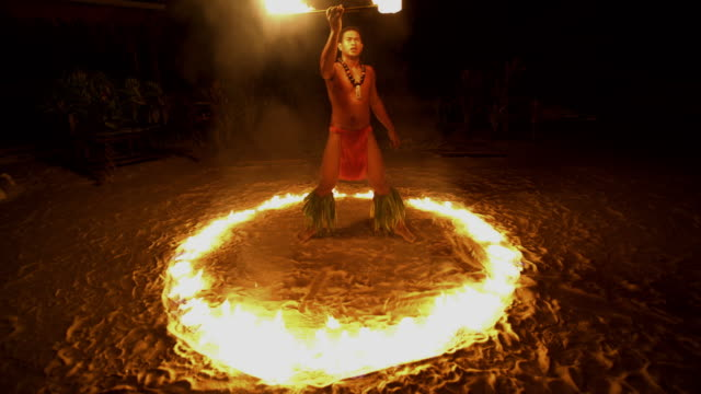 male polynesian dancer performing in ring of fire - tahitian culture stock videos & royalty-free footage